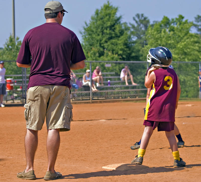 Download Father Coaching Daughter's Softball Stock Image - Image: 19599885
