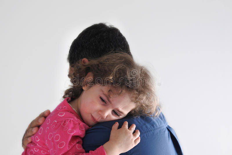 Father comforting his daugther royalty free stock photo