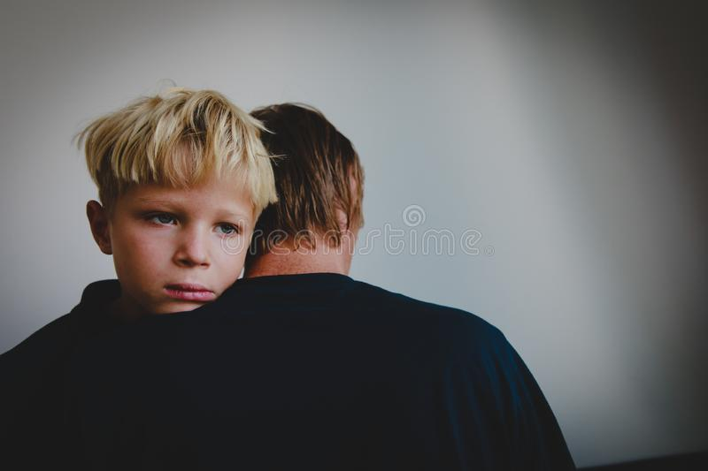 Father comforting stressed sad exhausted son, parenting. And care royalty free stock images
