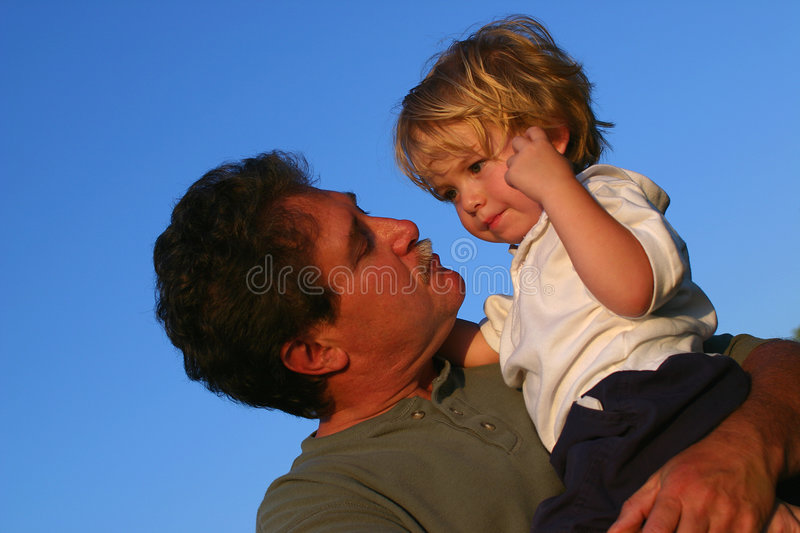 Father comforting young son royalty free stock photos