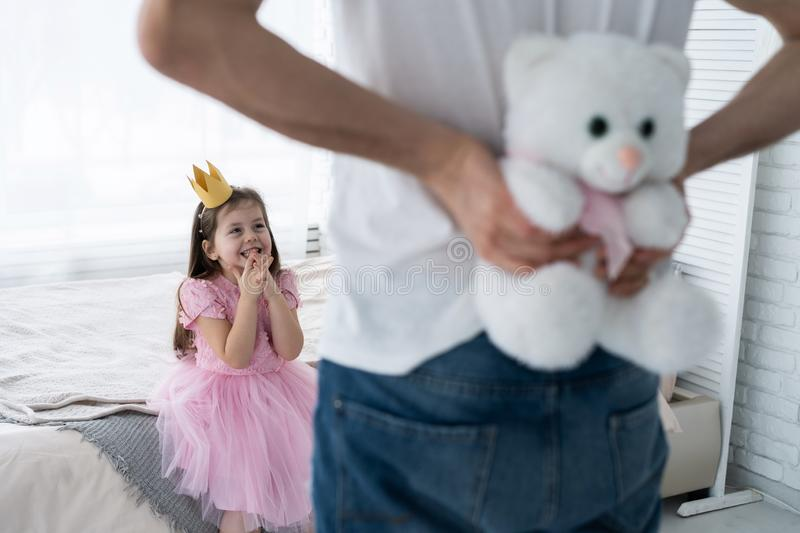 Father Congratulates Daughter with Happy Day 8 March. Daughter and Father Smile. Big Bear for Beautiful Daughter. Happiness and Springtime for Happy Daugter royalty free stock images