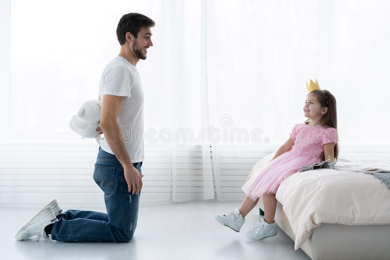 Father Congratulates Daughter with Happy Day 8 March. Daughter and Father Smile. Big Bear for Beautiful Daughter. Happiness and Springtime for Happy Daugter royalty free stock photo