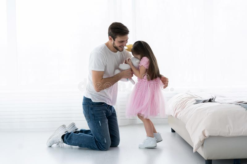 Father Congratulates Daughter with Happy Day 8 March. Daughter and Father Smile. Big Bear for Beautiful Daughter. Happiness and Springtime for Happy Daugter royalty free stock photography