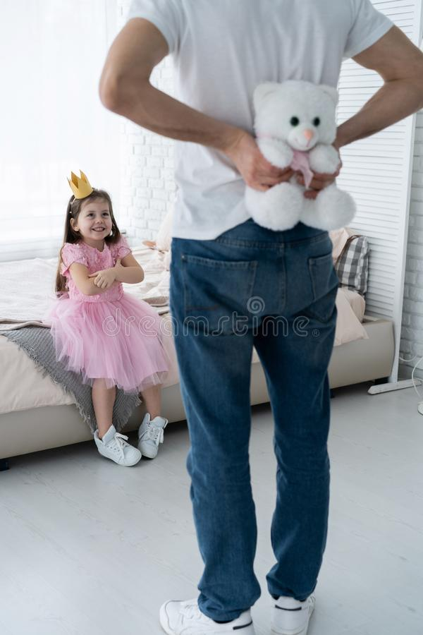 Father Congratulates Daughter with Happy Day 8 March. Daughter and Father Smile. Big Bear for Beautiful Daughter. Happiness and Springtime for Happy Daugter stock photography