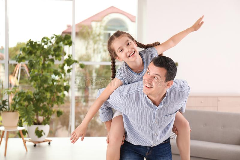 Father with cute child at home royalty free stock photos