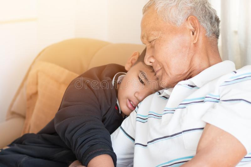 Father and Dad Day concept : Asian retired Grandfather and nephew or grandson, young boy hugging Living in house happily together stock image