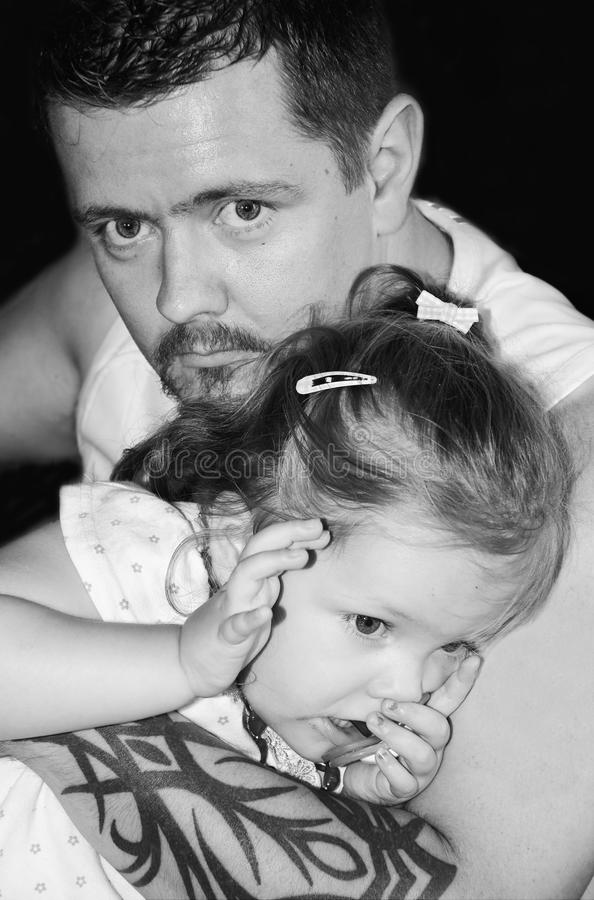 Father and daughter. Father protecting his small daughter stock photo