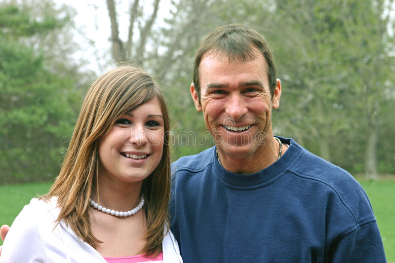 Father Daughter. Father and daughter with big smiles on their face royalty free stock photos