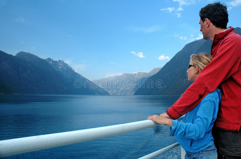 Father and daughter admiring scenery from ferry. Landscape image Norway, Nikon D70 royalty free stock images
