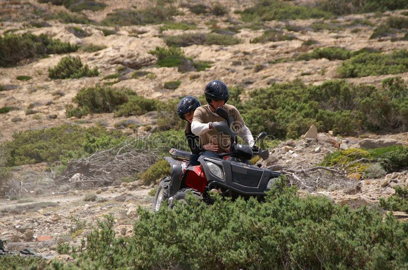 Father and daughter on an ATV royalty free stock photo