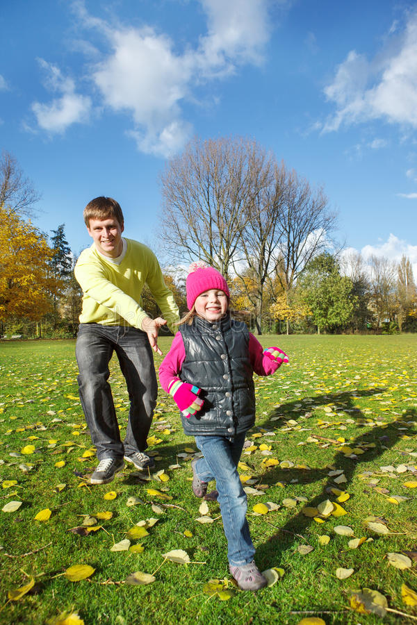 Father and daughter in autumn park royalty free stock image