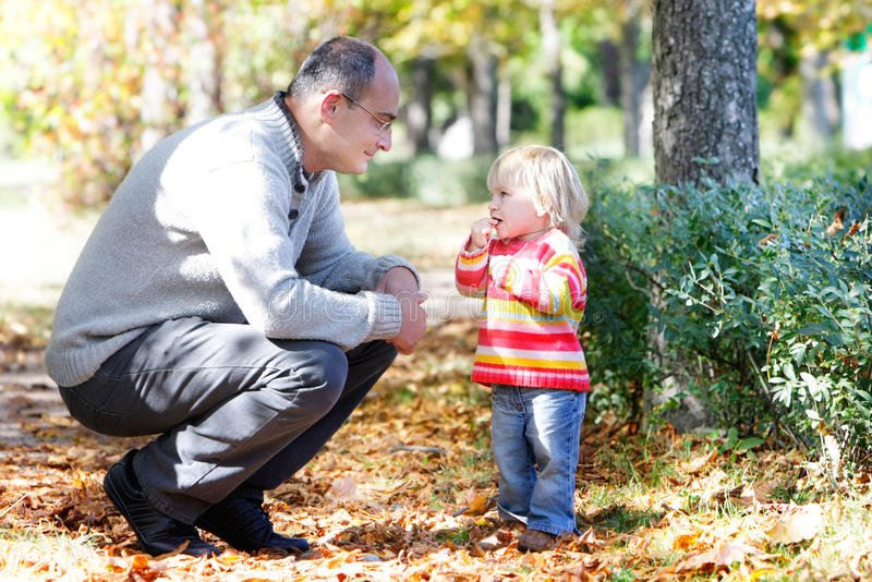 Download Father And Daughter On Autumn Park Backgro Stock Photo - Image: 16317632