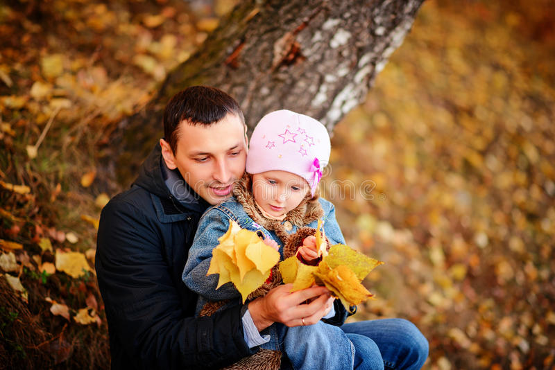 A father with daughter in autumn forest stock photos