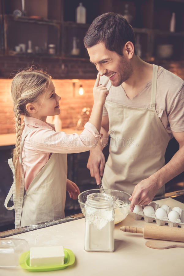 Father and daughter baking royalty free stock photos