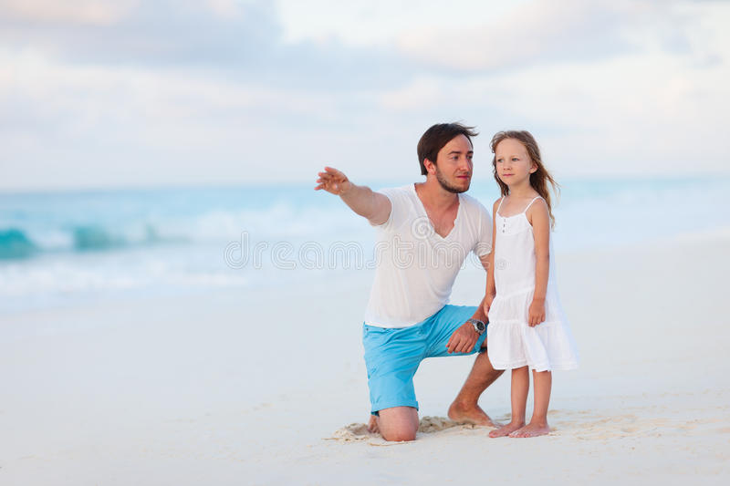 Father And Daughter At Beach Stock Photos