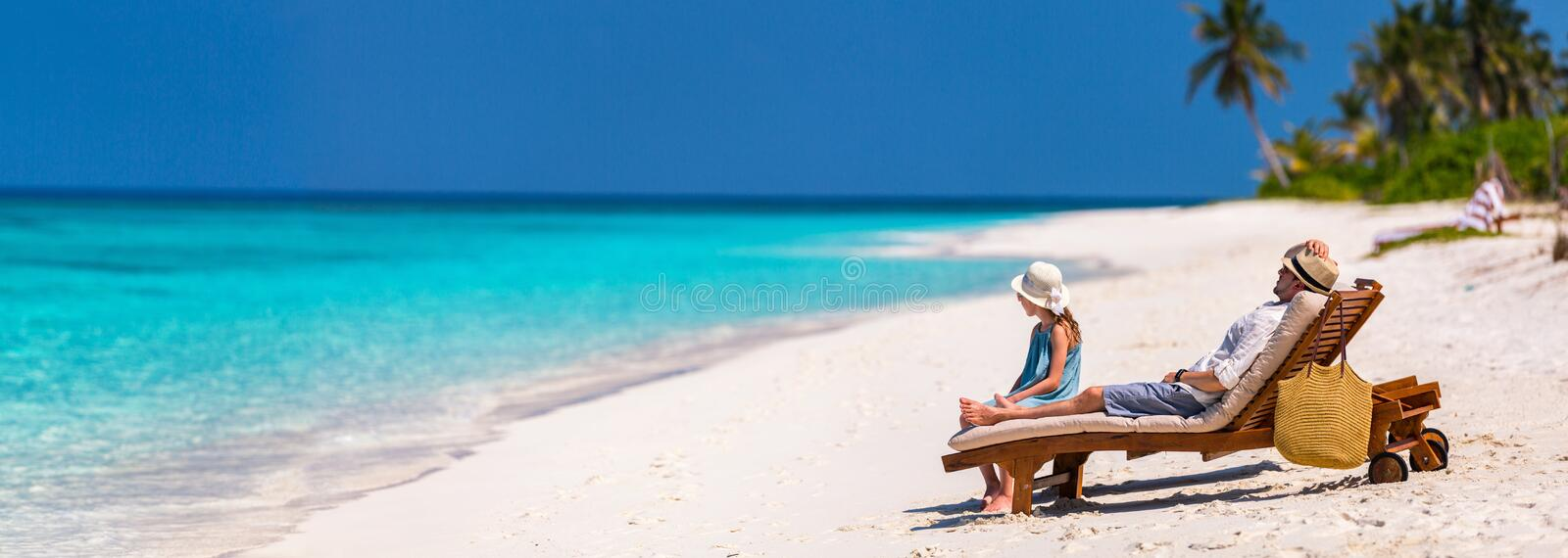 Father and daughter at beach. Panorama of father and his adorable little daughter at beach enjoying tropical vacation stock photos