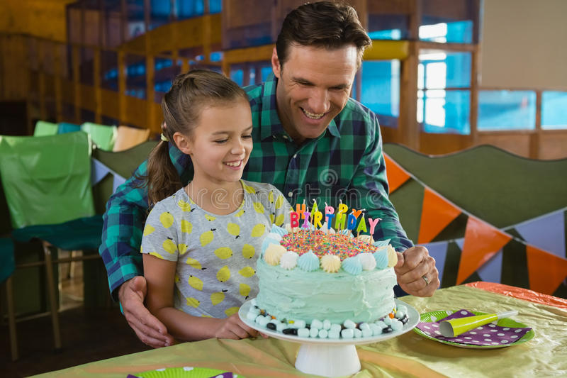 Father and daughter with birthday cake. At home royalty free stock photography