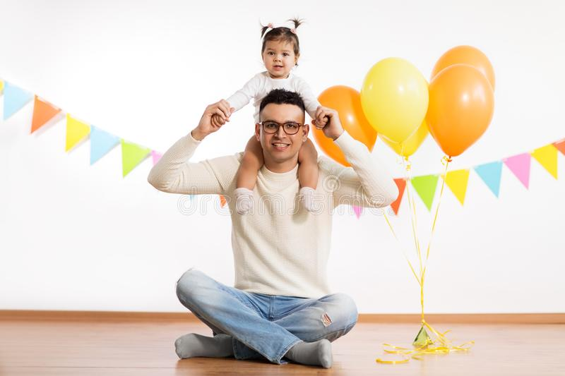 Father and daughter with birthday party balloons royalty free stock photo
