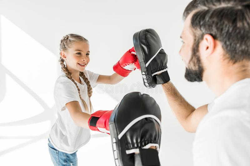 Father and daughter boxing together stock images