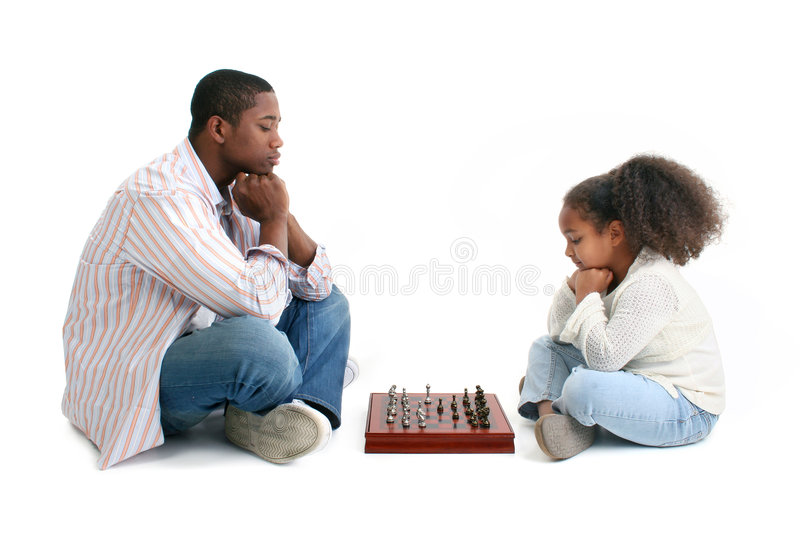 Father Daughter Chess Match. Father and daugther playing chess together over white background stock photo
