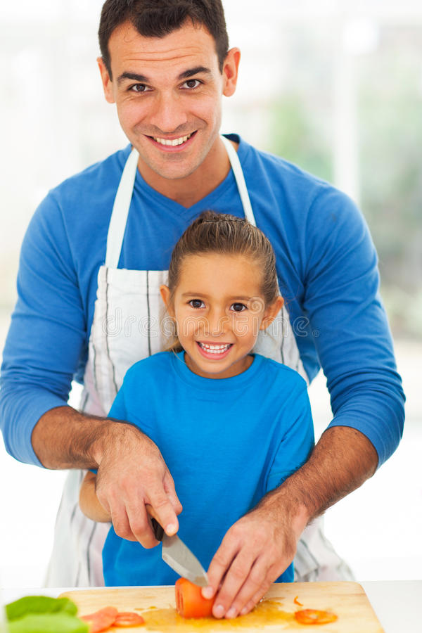Father daughter cooking stock photography