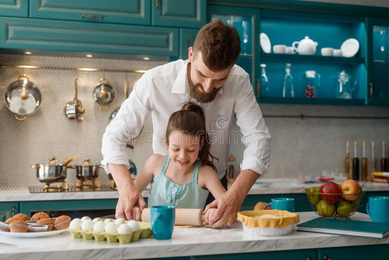 Father and daughter cooking together royalty free stock images