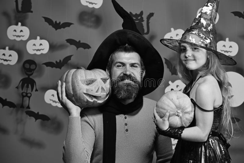 Father and daughter in costumes. Wizard and little witch stock image