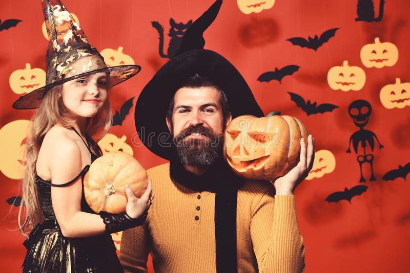 Father and daughter in costumes. Wizard and little witch royalty free stock photo