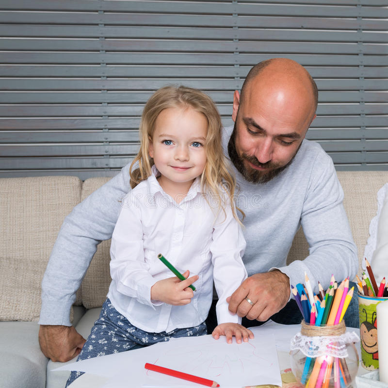 Father and daughter drawing together stock images