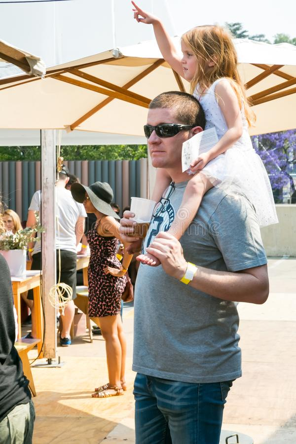 A father and daughter enjoying a day out at a Food and Wine Fair drinking and generally enjoying a day out at a Food and Wine Fair. Johannesburg, South Africa stock photos