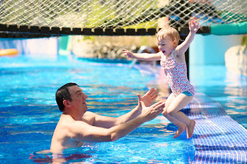 Father and daughter enjoying swimming pool stock image - Neonati in piscina ...