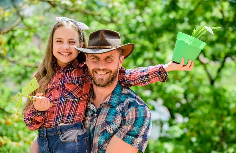 Father and daughter. family farm. agriculture. little girl and happy man dad. earth day. new life. spring village. Father and daughter. family farm. agriculture royalty free stock photo