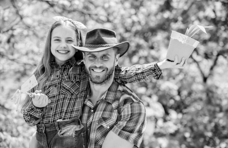 Father and daughter. family farm. agriculture. little girl and happy man dad. earth day. new life. spring village royalty free stock photos