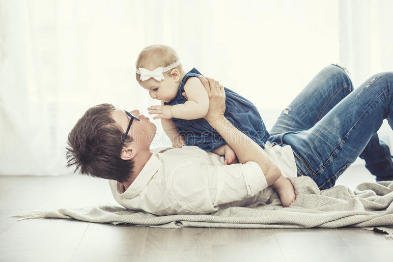 Father and daughter family happy together at home stock photos