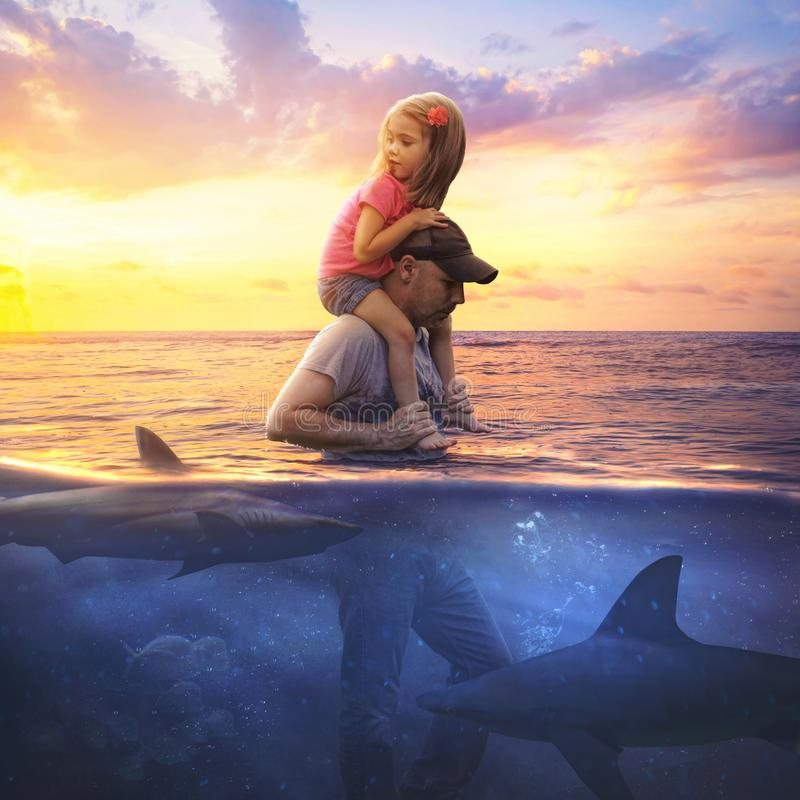 Father and daughter. Traveling through shark invested waters stock images