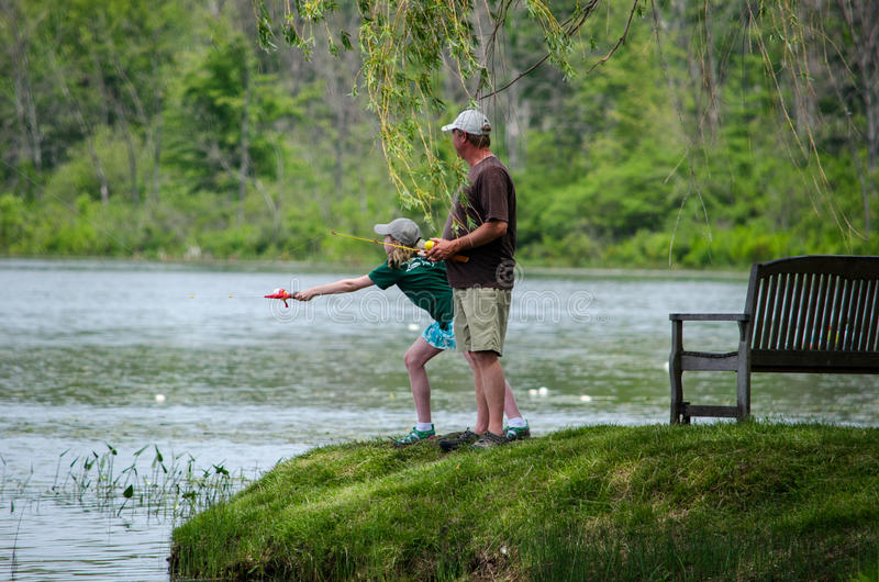 Father daughter fishing stock photography