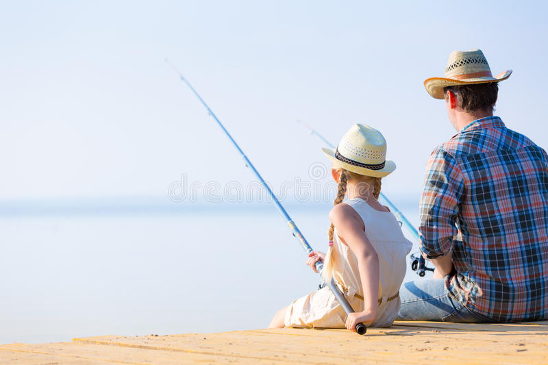 Father and daughter fishing royalty free stock image