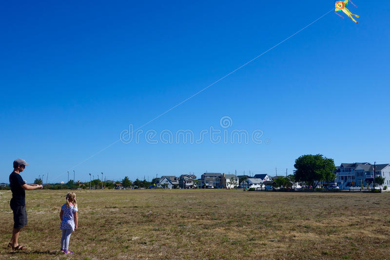 Father and daughter flying kite royalty free stock photography