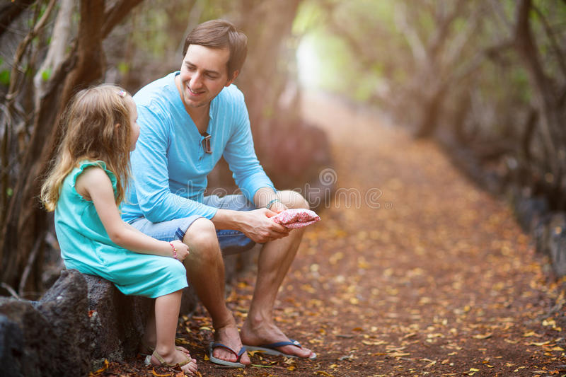 Father and daughter at forest stock images