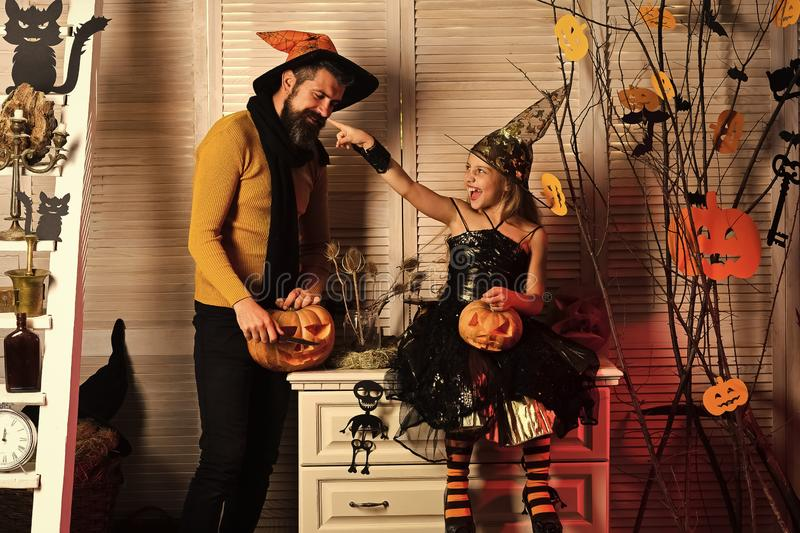 Father and daughter with Halloween decor. Girl and bearded man stock image