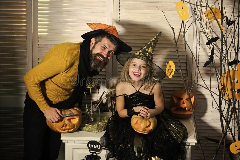 Father and daughter with Halloween decor. Girl and bearded man royalty free stock photo