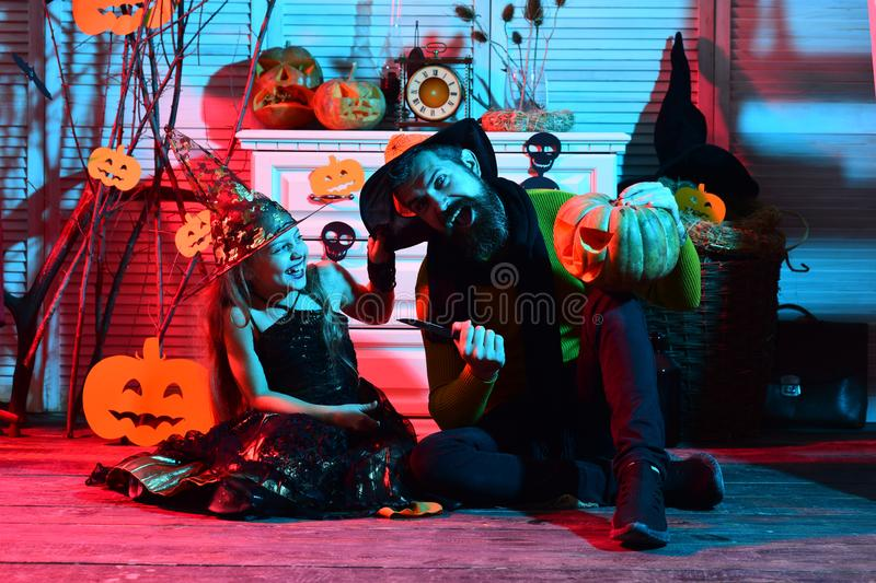 Father and daughter with Halloween decor. Halloween party stock images