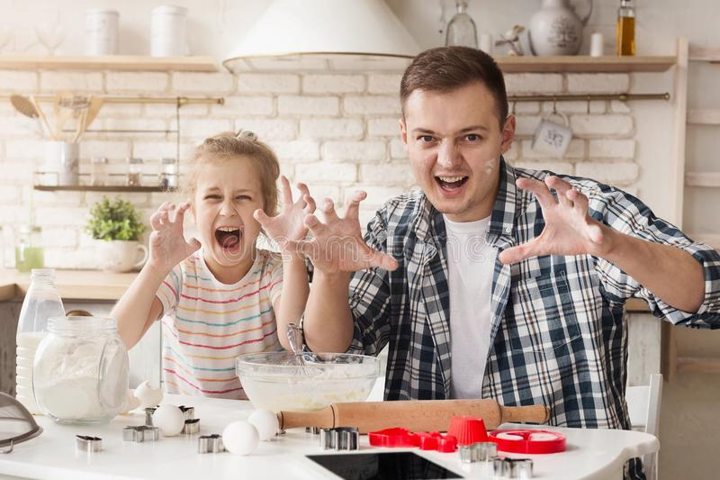 Father and daughter having fun while baking royalty free stock photography