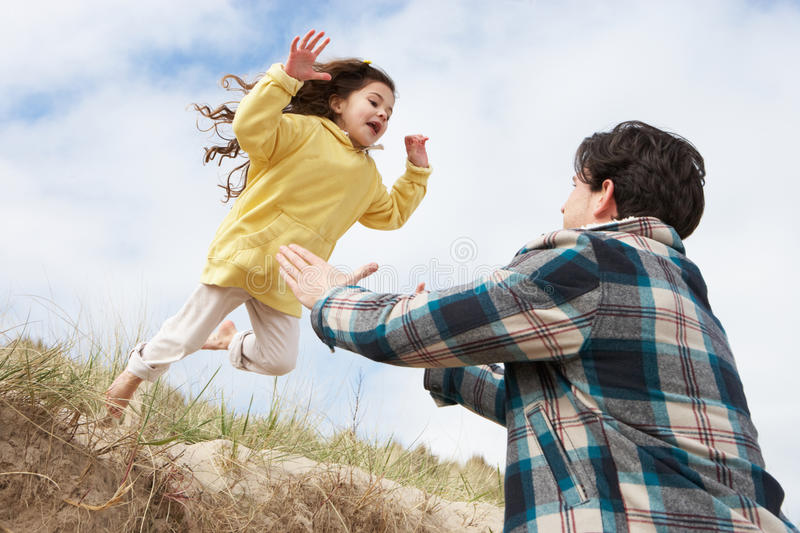 Download Father And Daughter Having Fun On Beach Together Stock Image - Image: 16134359