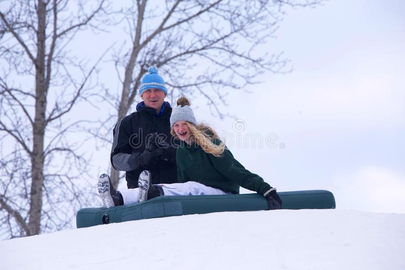 Father and daughter having fun in winter stock photography