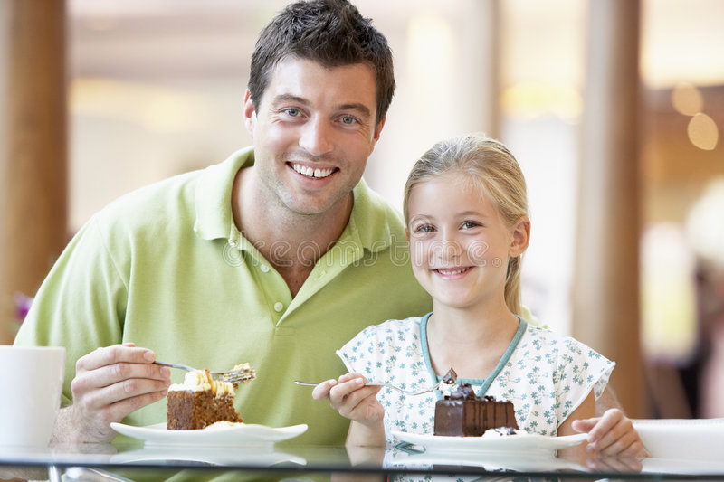 Father And Daughter Having Lunch Together stock images