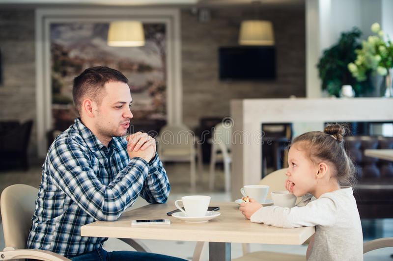 Father And Daughter Having Lunch Together At The Mall stock image