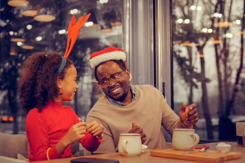 Father and daughter having their holiday lunch together stock images