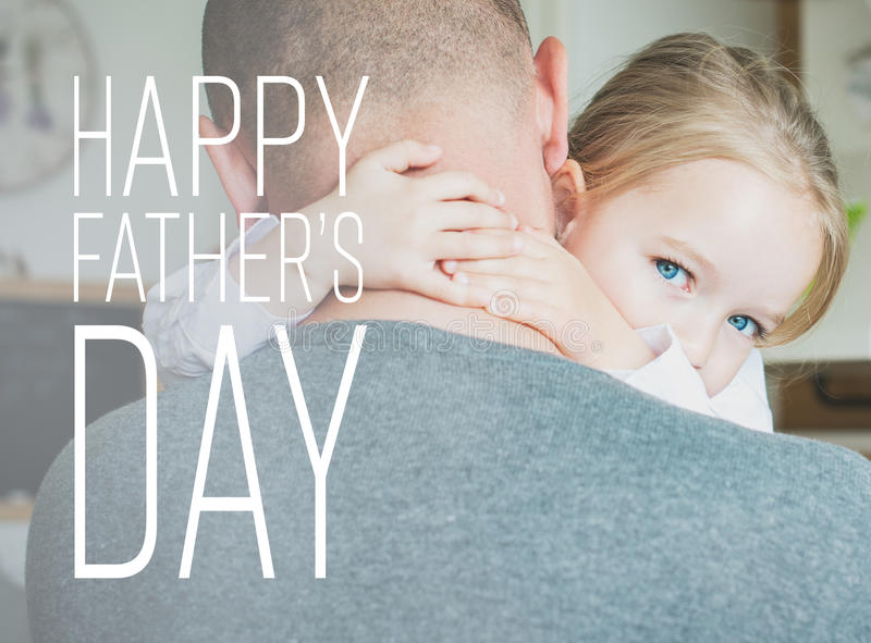 Father and daughter in the kitchen, father`s day concept. Real family royalty free stock photography