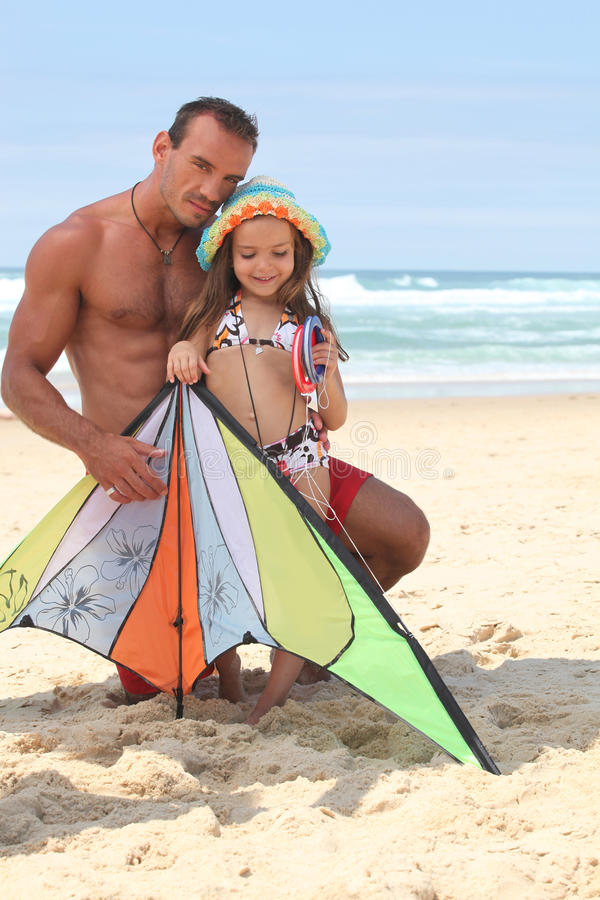 Father and daughter with kite royalty free stock photo